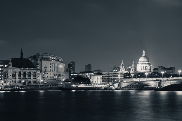 London skyline at night with bridge and St Pauls Cathedral over